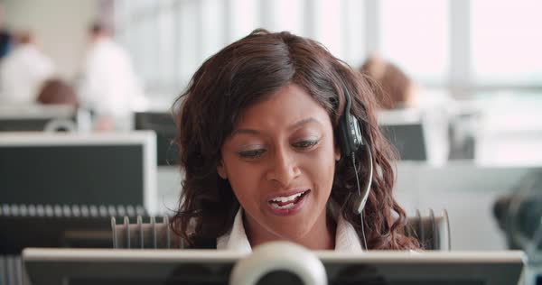 Mixed race woman working in a call centre using a headset Royalty-free stock video