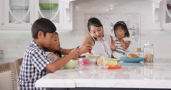 Busy mother organizing children at breakfast Royalty-free stock video