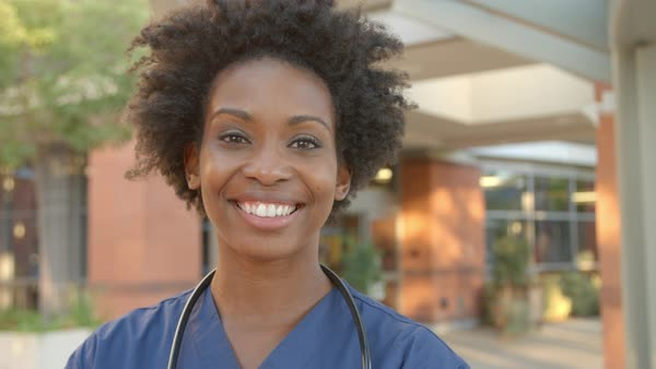 Portrait of nurse standing outside hospital Royalty-free stock video