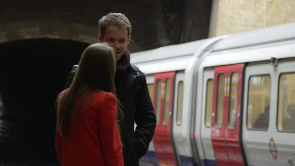 Couple standing on railway station platform Royalty-free stock video