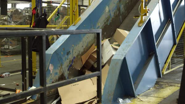 Cardboard for recycling moving on conveyor belt Royalty-free stock video