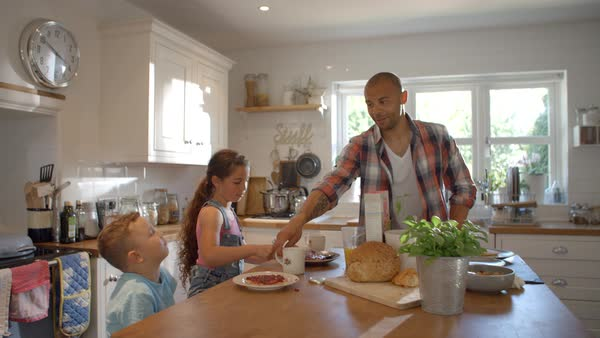Father And Children At Home Eating Breakfast In Kitchen Royalty-free stock video