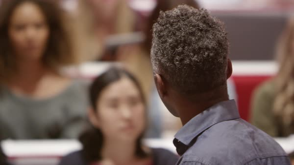 Close up back view of male teacher lecturing university students, shot on R3D Royalty-free stock video