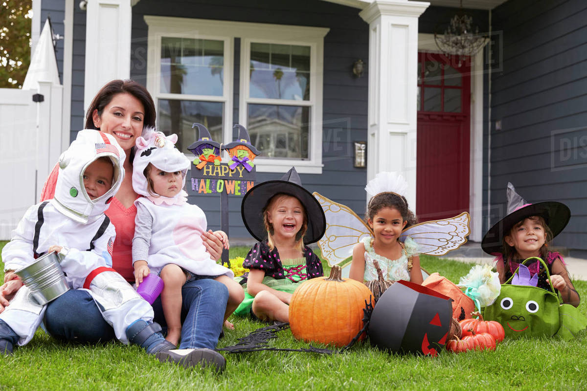 Children Dressed In Trick Or Treating Costumes On Lawn Royalty-free stock photo