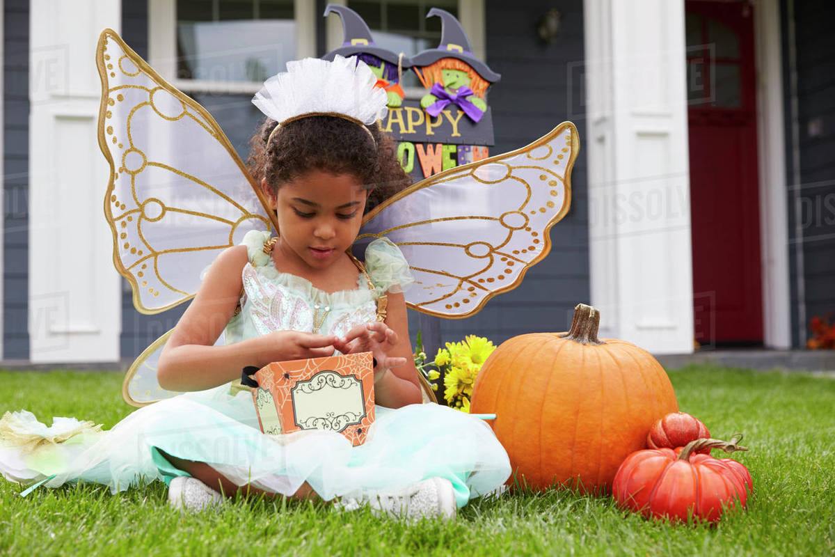 Girl Dressed In Trick Or Treating Fairy Costume On Lawn Royalty-free stock photo