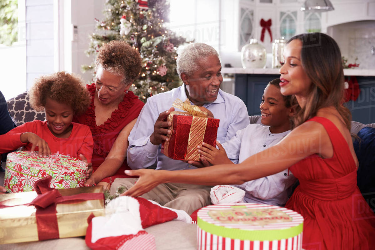 Family with grandparents opening Christmas gifts - Stock Photo ...