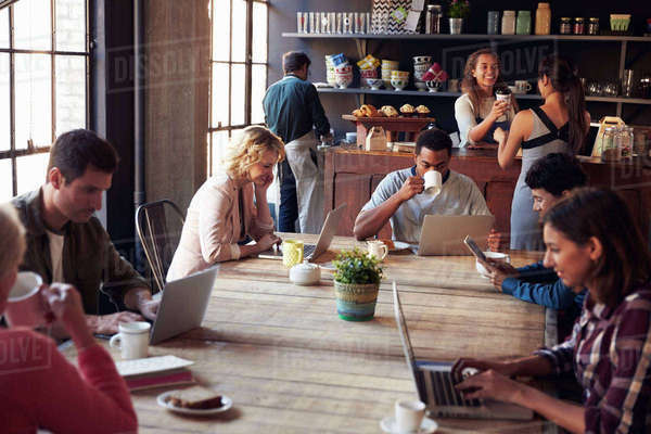 Interior Of Coffee Shop With Customers Using Digital Devices Royalty-free stock photo