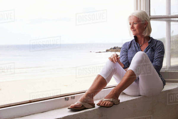 Woman Sitting At Window And Looking At Beautiful Beach View Royalty-free stock photo