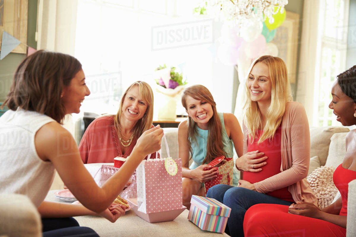 Group Of Female Friends Meeting For Baby Shower At Home Stock Photo Dissolve