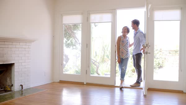 Excited couple explore new home on moving day Royalty-free stock video
