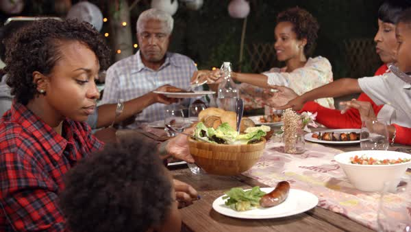 Multi generation family serving food at table outdoors Royalty-free stock video