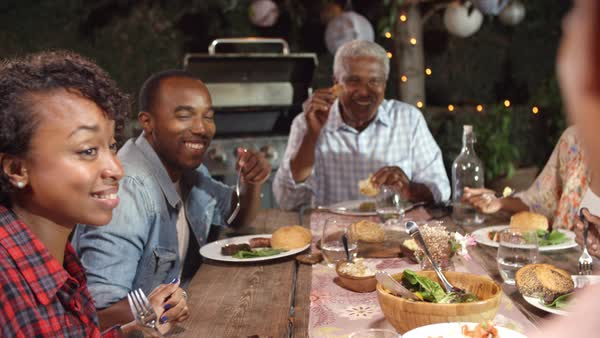 Adult family eating outside at a dinner table Royalty-free stock video