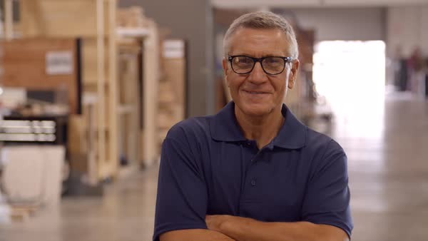 Male factory worker walks towards camera in slow motion Royalty-free stock video