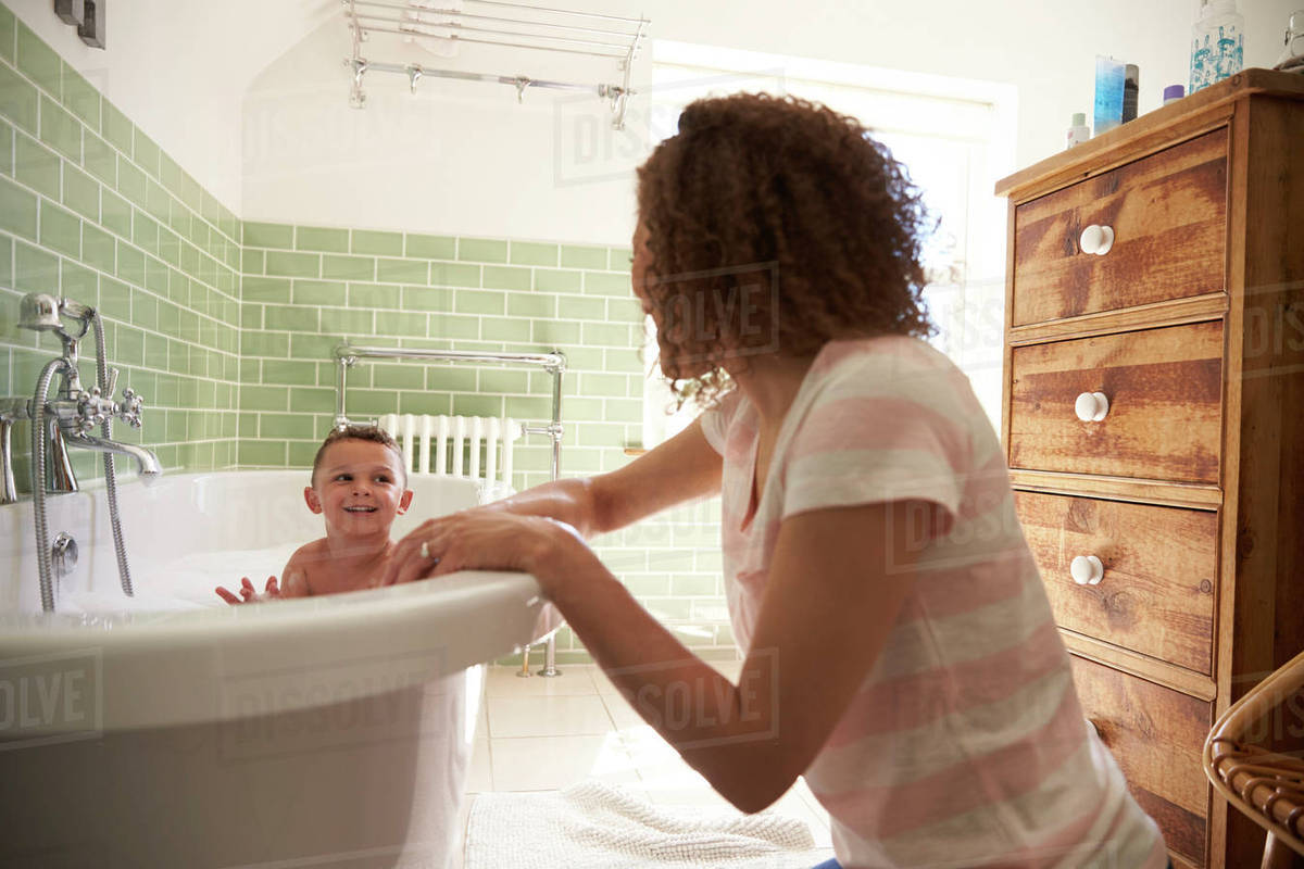 Mother and son having fun at bath time together - Stock Photo - Dissolve