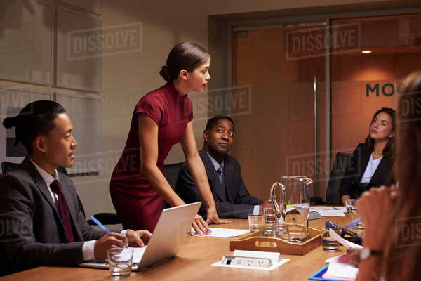 Female manager  standing to address team at business meeting Royalty-free stock photo