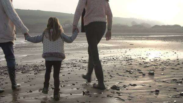 Grandmother,mother and daughter walking along beach in slow motion. Royalty-free stock video