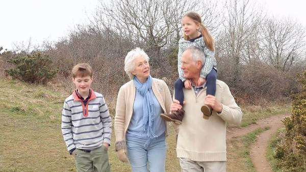 Grandparents with grandchildren on walk in countryside Royalty-free stock video
