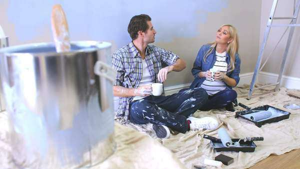 Couple expecting baby take a break from decorating nursery and have hot drink.Shot on Sony FS700 at a frame rate of 25 fps Royalty-free stock video