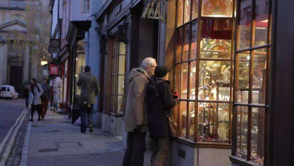 Senior couple looking in window of Oxford antique shop at dusk.Shot on Canon 5D MkII at a frame rate of 25fps Royalty-free stock video