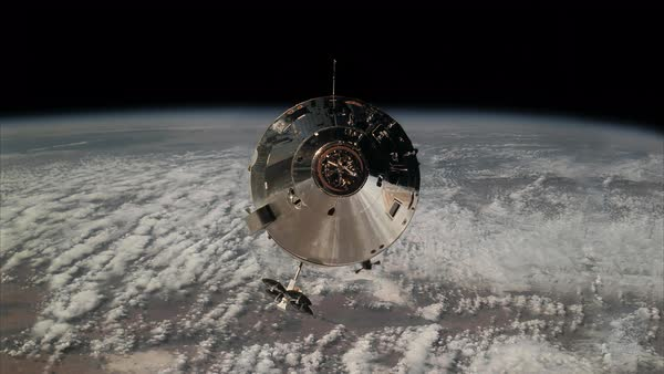 Locked off shot of a spacecraft flying above the earth Rights-managed stock video