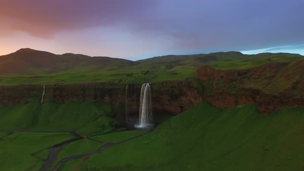 Seljalandsfoss waterfall with green landscape at sunrise Royalty-free stock video