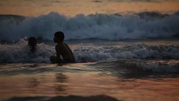 Medium shot of people swimming in the sea in India Royalty-free stock video