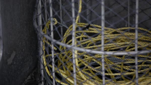 Close-up shot of rope coiling into a basket Royalty-free stock video