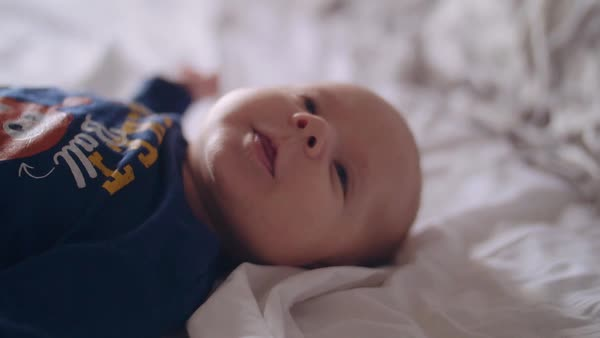 Baby boy lying on bed Royalty-free stock video