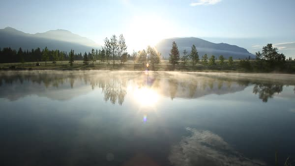 Timelapse mist moving over mountain lake Royalty-free stock video