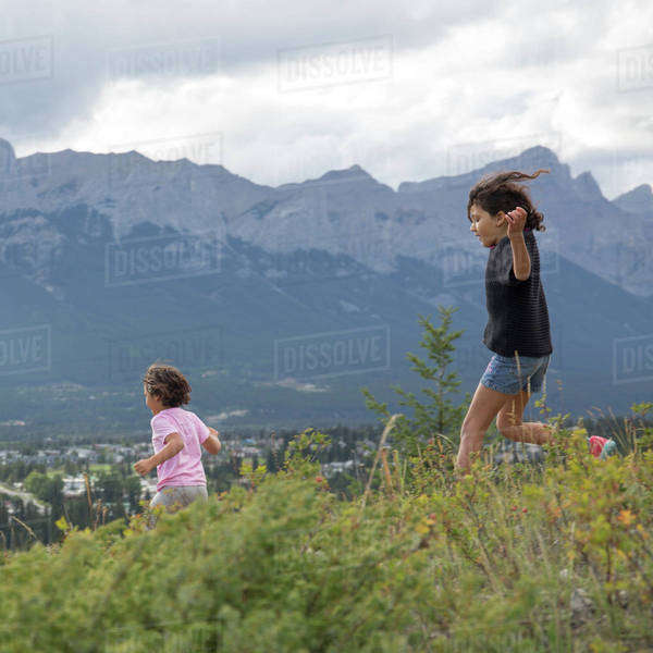 Girls running downhill Royalty-free stock photo