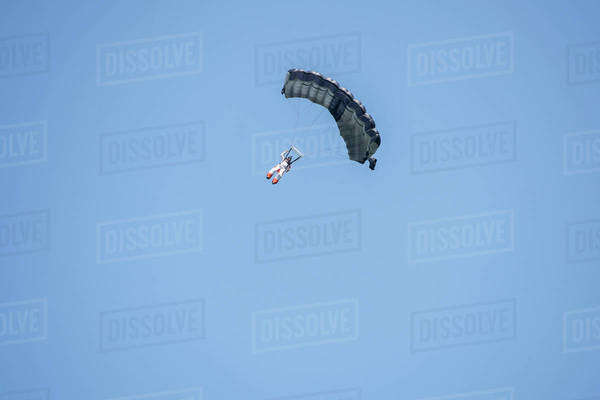 Skydiver gliding in the sky in Ticino canton, Switzerland Royalty-free stock photo