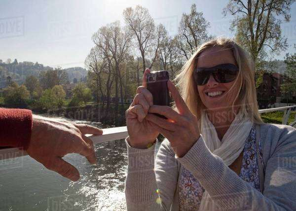 Woman taking pictures with her smartphone Royalty-free stock photo