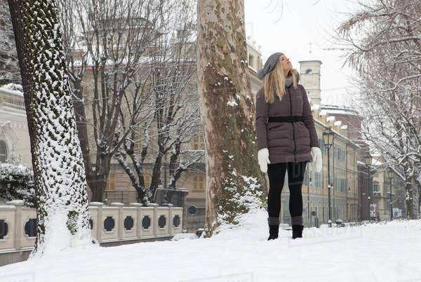 Woman standing in a park in winter Royalty-free stock photo