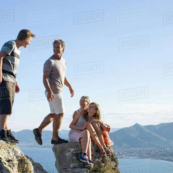 Family on a rock Royalty-free stock photo