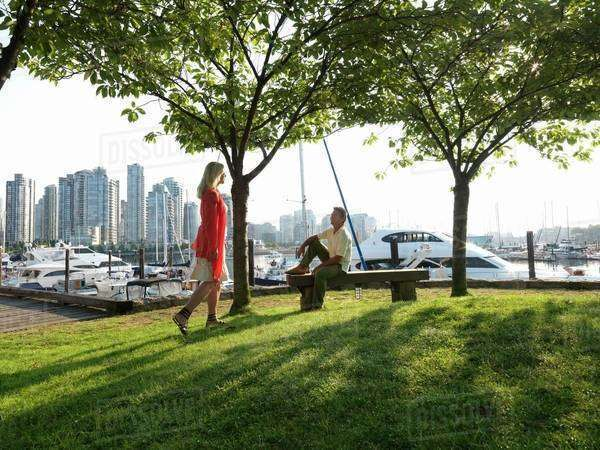 Two people meeting in a park in Canada, Vancouver Royalty-free stock photo