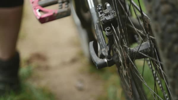 Young girl pushing her mountain bicycle in slow motion during autumn Royalty-free stock video
