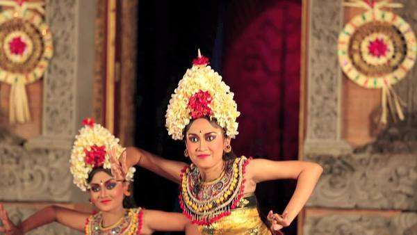 Balinese Dancers In Traditional Costume Performing On Stage In The