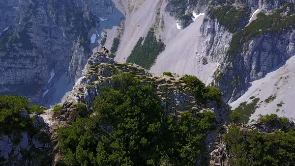 Aerial shot of hiker on top of the mountain ridge Royalty-free stock video