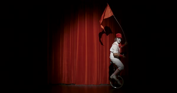 A male juggler riding unicycle during his stage performance Royalty-free stock video