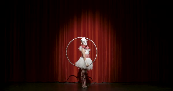 A female circus artist performing with a hula hoop ring during her stage performance Royalty-free stock video
