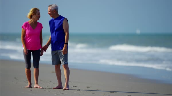 Mature couple enjoying running on the beach Royalty-free stock video