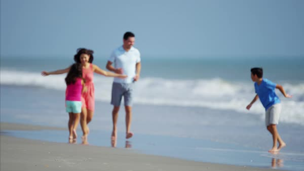 Carefree family relaxing on their beach vacation outdoors Royalty-free stock video