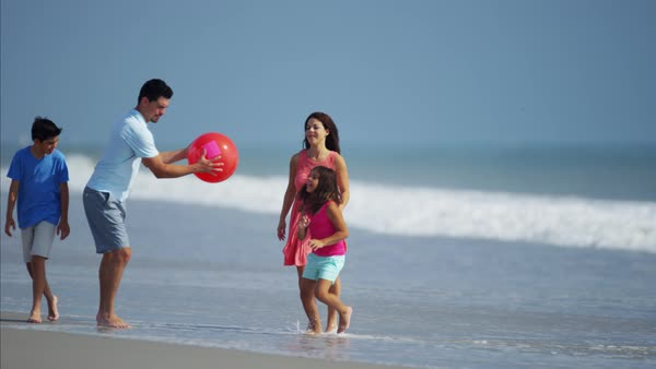 Family having fun with red ball on beach vacation Royalty-free stock video
