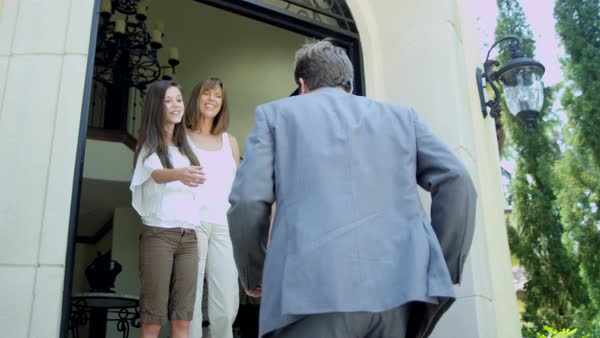 Professional Caucasian businessman returning home from successful business trip and greeting loving family with teen daughters Royalty-free stock video
