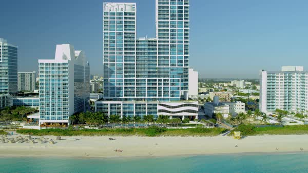 Aerial view Miami South Beach vacation resort hotels and condominiums Biscayne Bay Miami Florida USA Royalty-free stock video