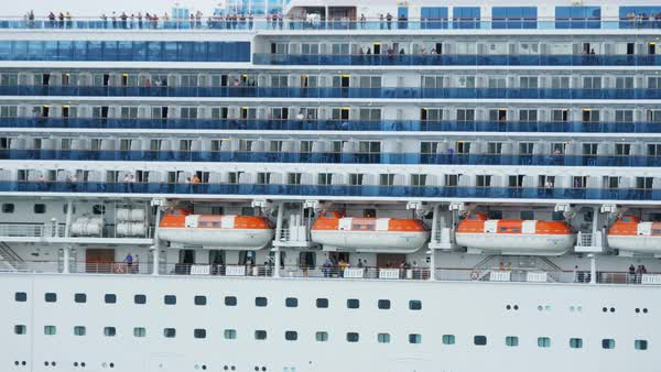 Luxury ocean going cruise liner bringing vacation passengers into port Royalty-free stock video
