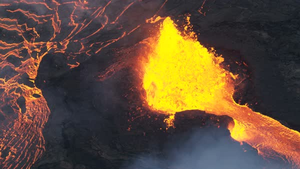Aerial view of spewing boiling red hot magma erupting skywards from