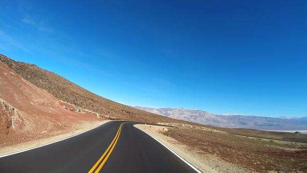 POV road trip Death Valley hot dry landscape vehicle motion sun flare USA Royalty-free stock video