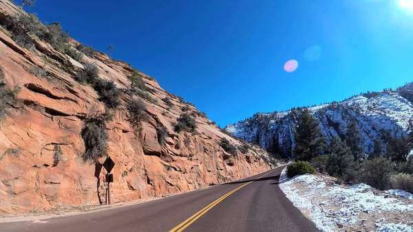 POV road trip driving sandstone landscape vehicle extreme climate snow Zion Utah USA Royalty-free stock video