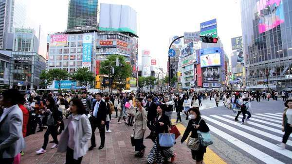 Illuminated city advertising Tokyo Shibuya pedestrian road crossing Japan Royalty-free stock video